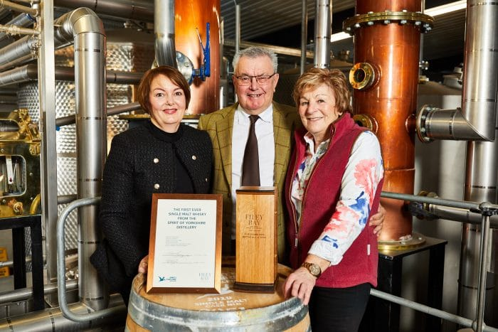 The winner of Filey Bay First Release Bottle No. 1 John, with his wife and daughter on the presentation day at The Spirit of Yorkshire Distillery