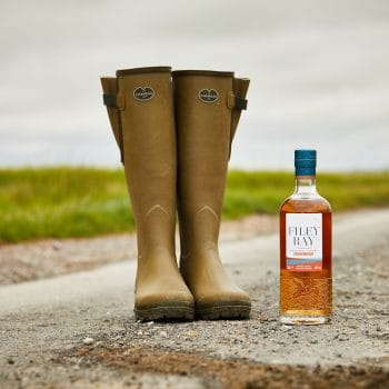 Le Chameau boots with a bottle of Filey Bay Moscatel Finish Single Malt Whisky