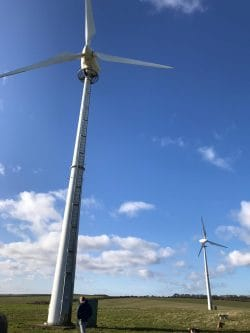 The two wind turbines at Hunmanby Grange against a beautiful blue sky